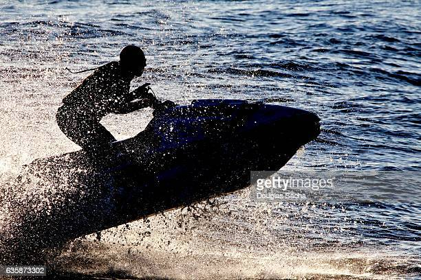 Silhouette of Extreme watercraft rider