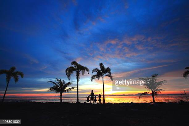 silhouette of family during sunset - malaysia beautiful girl stock photos and pictures
