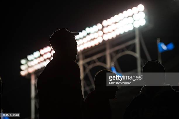 A silhouette of Fans returning from the concession stands during the Opening Night game between the Chicago Cubs and the St Louis Cardinals at...