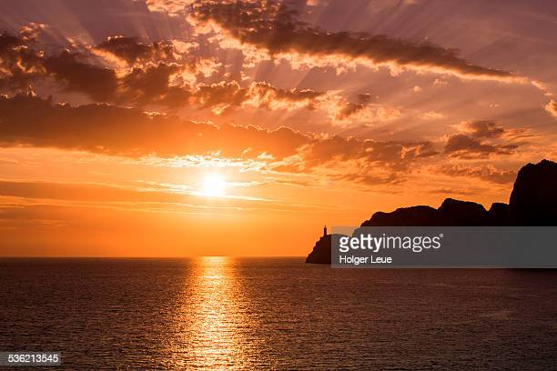 Silhouette of Faro di Capri lighthouse at sunset