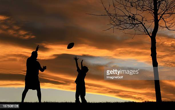 Silhouette of Father Playing Football With His Son