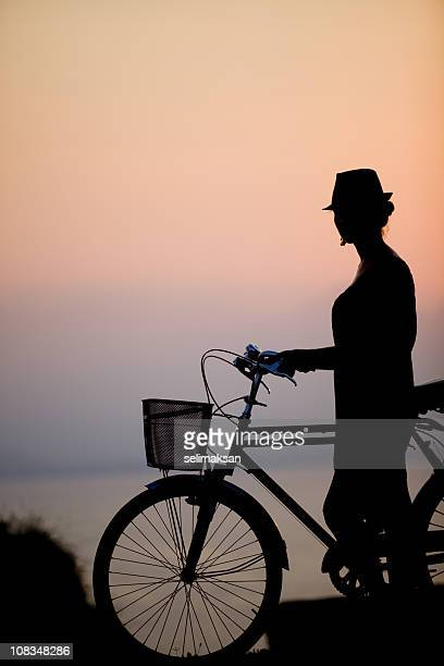 Silhouette of female cyclist
