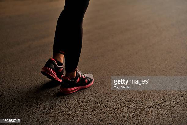 Silhouette of female feet to the jogging