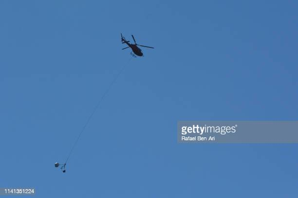 Silhouette of fire fighter helicopter
