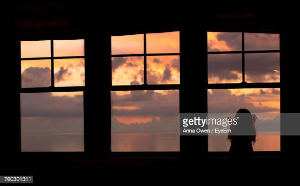 Silhouette Of Girl Against Window
