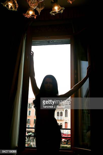 Silhouette of girl by window