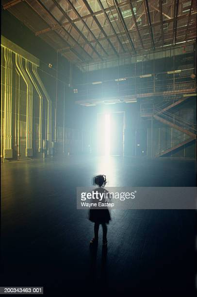 Silhouette of girl (3-5) on sound stage, rear view