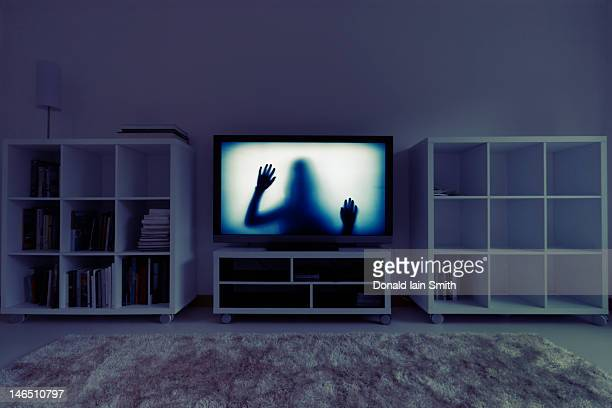 silhouette of girl on television - spooky stock pictures, royalty-free photos & images