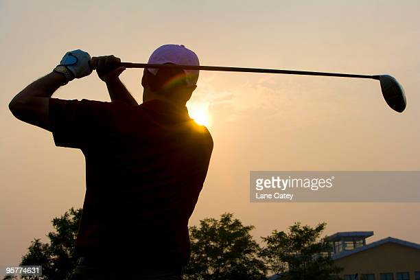 Silhouette of Golfer at Sunset