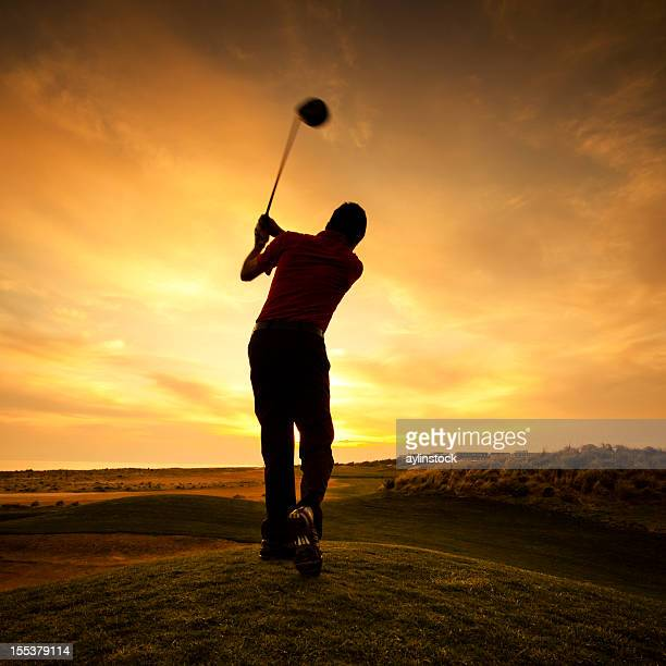 Silhouette of golfer during sunset