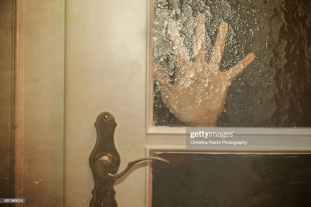 Silhouette  of Hand Coming opening the door slowly : Stock Photo