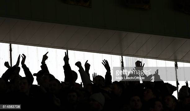 A silhouette of hands as Leicester fans gesture towards the visiting supporters during the Barclays Premier League match between Leicester City and...