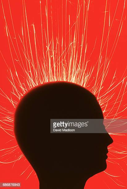 Silhouette of head with sparks