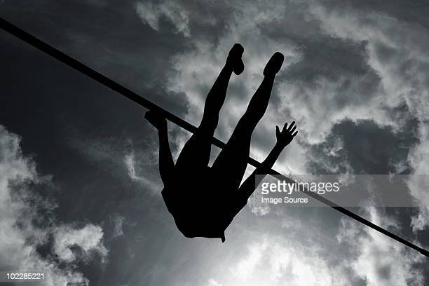 silhouette of high jumper - high jump stock pictures, royalty-free photos & images
