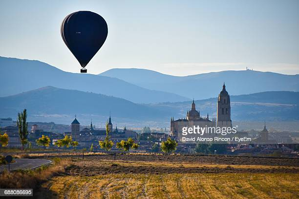 silhouette of hot air balloon with landscape and mountain against sky - segovia stock pictures, royalty-free photos & images