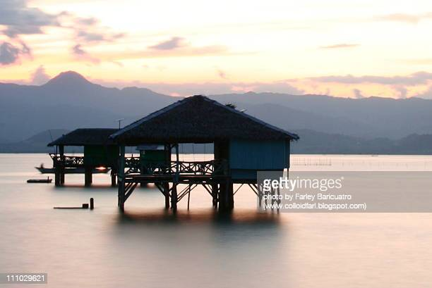 Silhouette of huts during sunrise