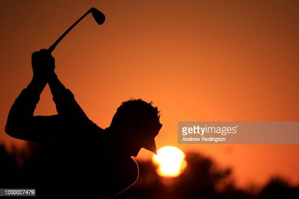 Silhouette of Ian Poulter of England as he warms up on the range ahead of his Round Two match during Day Two of the Abu Dhabi HSBC Championship at...