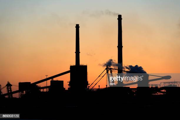 Silhouette of  Industrial Plant Against Sunset Sky