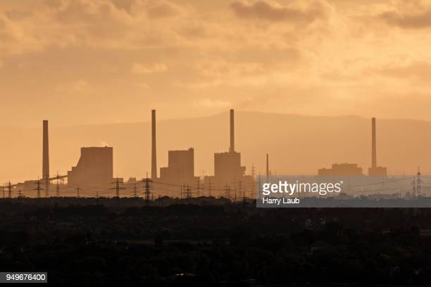 Silhouette of industrial site, Heating Plant Mannheim in backlight, evening light, Rhein-Neckar-Kreis, Baden-Wuerttemberg, Germany
