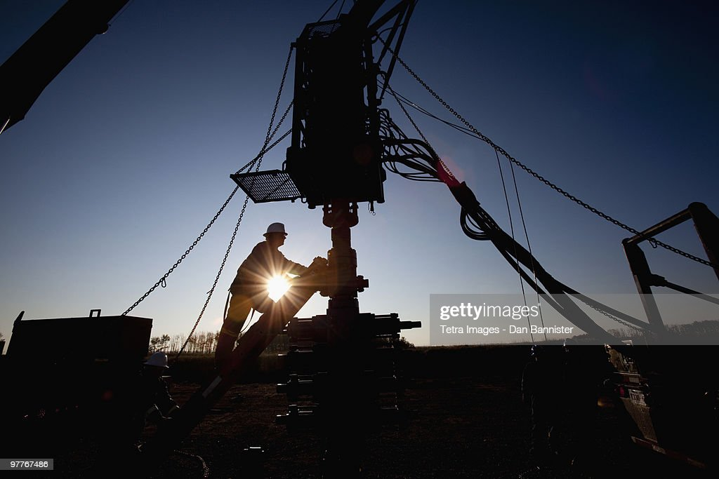 Silhouette of industrial worker : Stock Photo