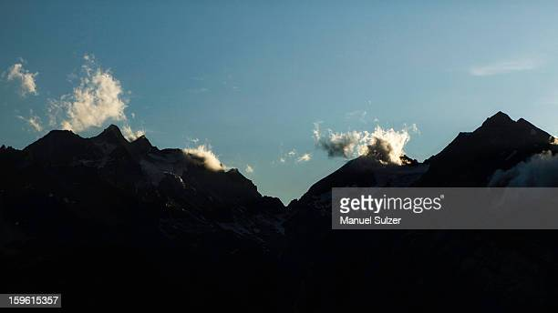 Silhouette of jagged mountain range