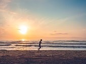 silhouette jogging man beach morning at