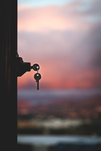Silhouette of keys and door lock against cityscape, Malaga, Spain - gettyimageskorea