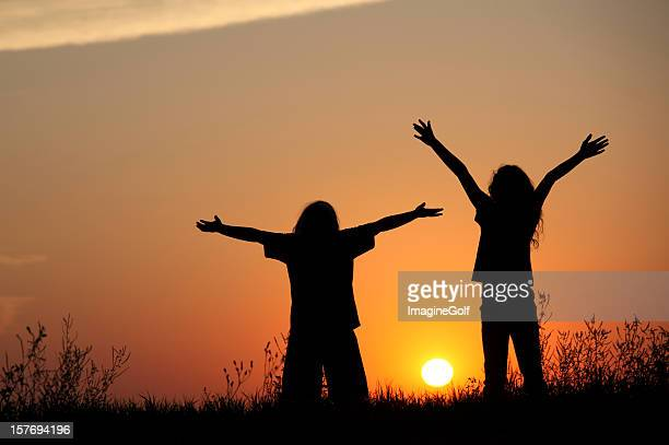 Silhouette of Kids Praising God