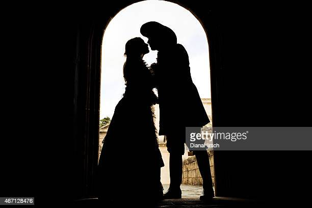 silhouette of kissing romeo and juliet - actor stock pictures, royalty-free photos & images