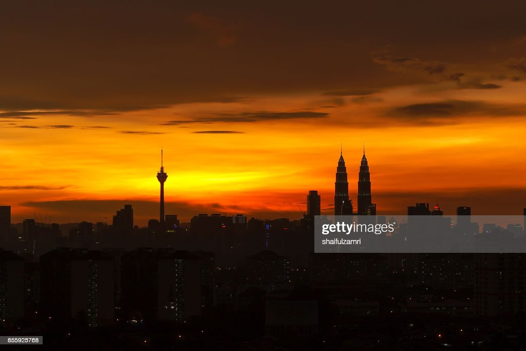 Silhouette of Kuala Lumpur skyline during sunset in Malaysia with Petronas Twin Towers is the highest in the horizon. : Stock Photo