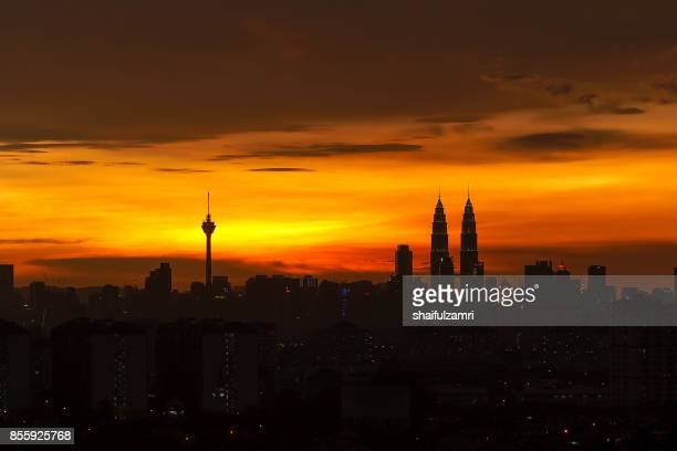 silhouette of kuala lumpur skyline during sunset in malaysia with petronas twin towers is the highest in the horizon. - shaifulzamri stock pictures, royalty-free photos & images