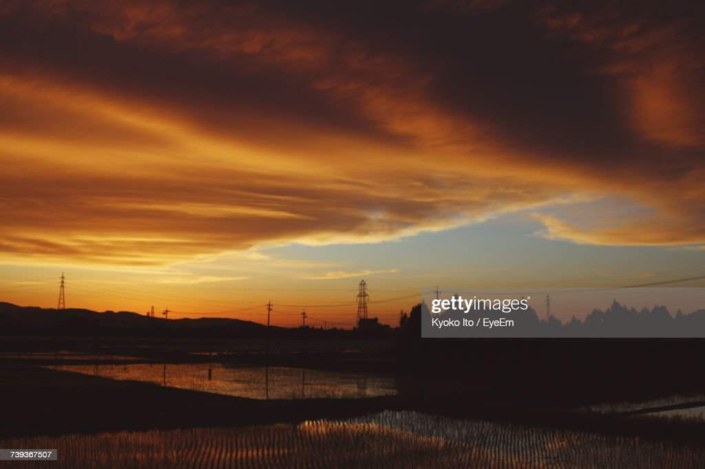 Silhouette Of Landscape Against Cloudy Sky During Sunset : Stock Photo