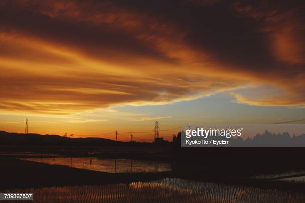 silhouette of landscape against cloudy sky during sunset - fukui prefecture - fotografias e filmes do acervo