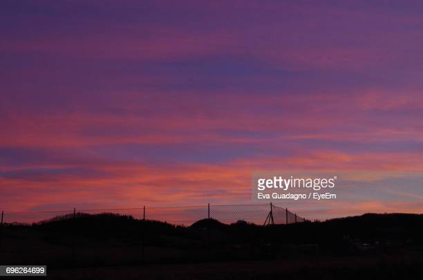 Silhouette Of Landscape Against Dramatic Sky