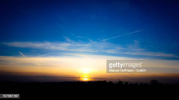 Silhouette Of Landscape Against Sky At Sunset