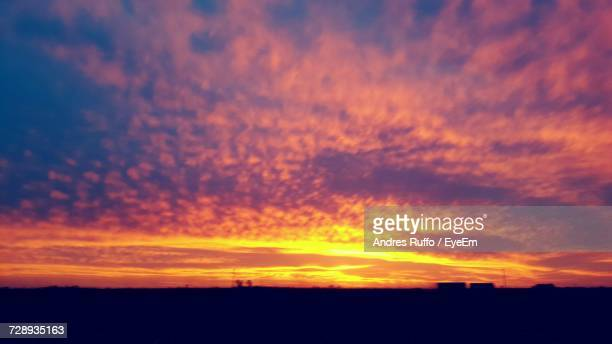 silhouette of landscape at sunset - andres ruffo stock-fotos und bilder