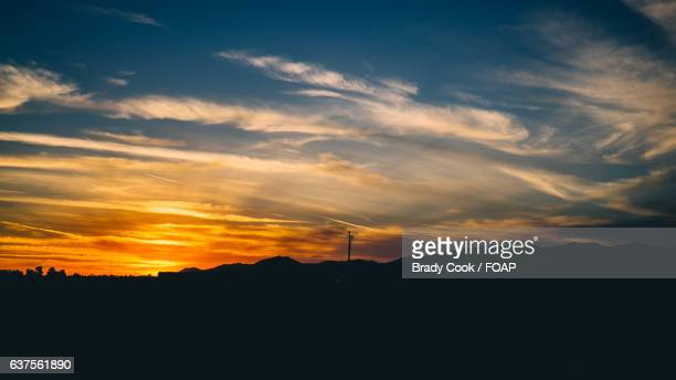 silhouette of landscape during sunset - goodyear arizona stock photos and pictures