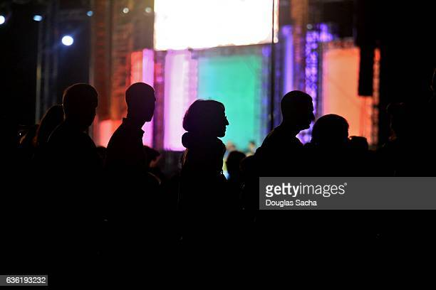 Silhouette of large group of spectators at a night time performance