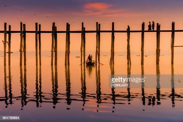 silhouette of life at u-ben bridge, mandalay, myanmar - myanmar stock pictures, royalty-free photos & images