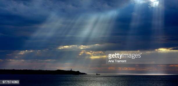 Silhouette of lighthouse at sunset, Santander, Spain