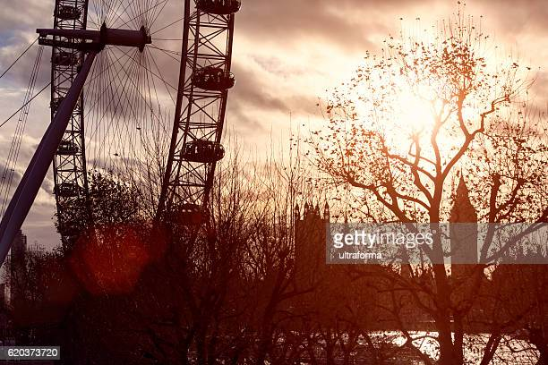 Silhouette of London Eye and Big Ben at sunset