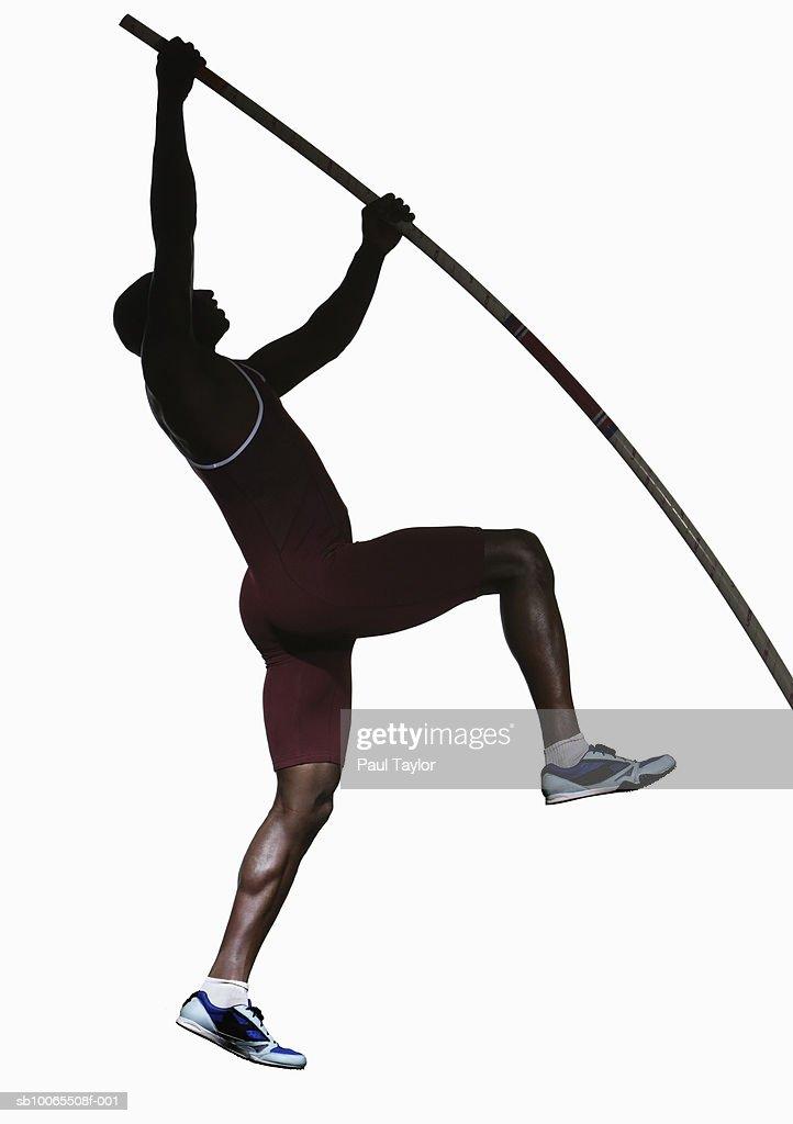 vault gymnastics silhouette. Silhouette Of Male Athlete Pole Vaulting, Side View : Stock Photo Vault Gymnastics