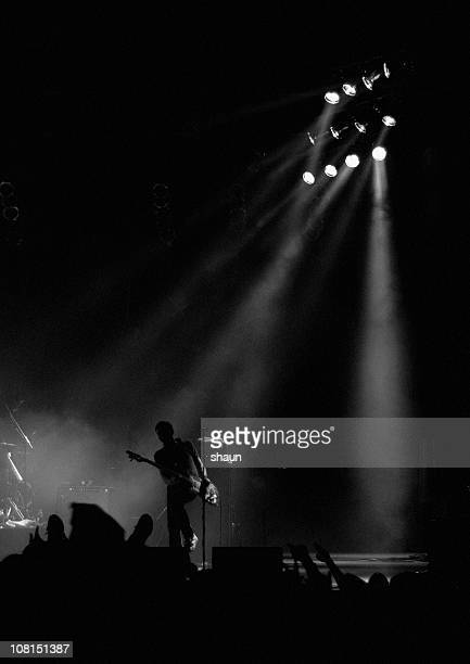 silhouette of male guitariston stage at show - entertainment occupation stock pictures, royalty-free photos & images