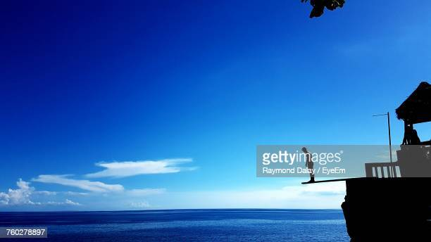 Silhouette Of Man Against Clear Blue Sky