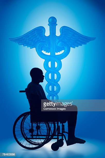 Silhouette of man and a caduceus