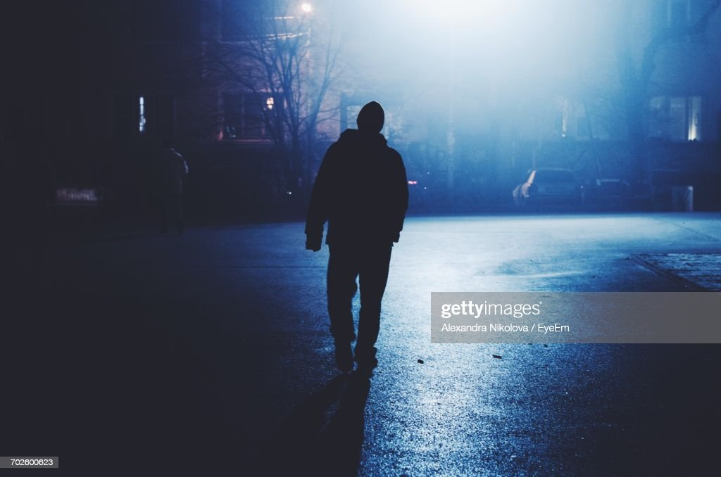 Silhouette Of Man At Night : Stock-Foto