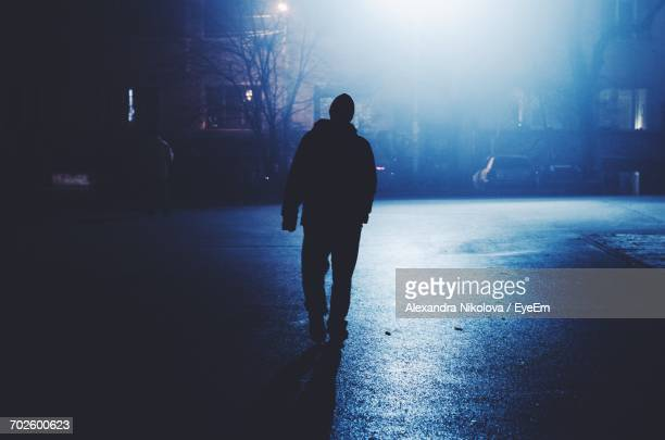 Silhouette Of Man At Night