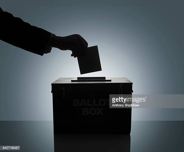 Silhouette of man casting his vote