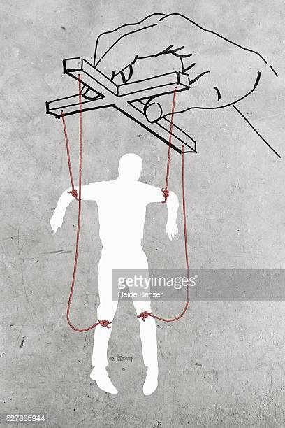 Silhouette of man dangling on threads