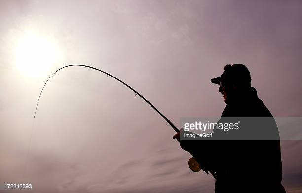 silhouette of man deep sea salmon fishing - big game fishing stock photos and pictures
